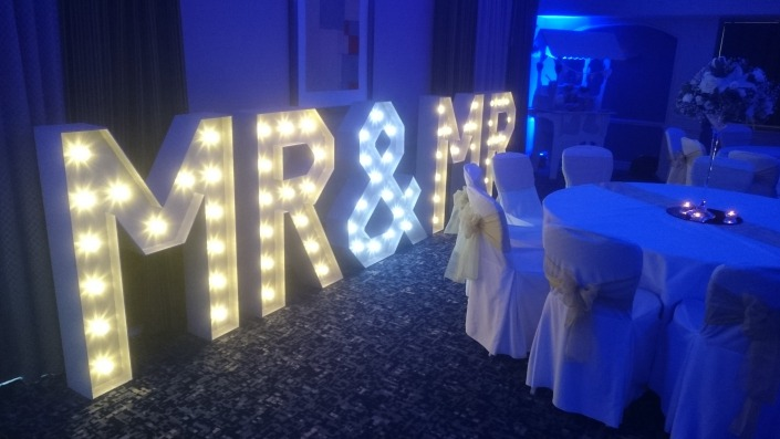mr and mr light up vintage letters with blue uplighters at solent hotel and spa