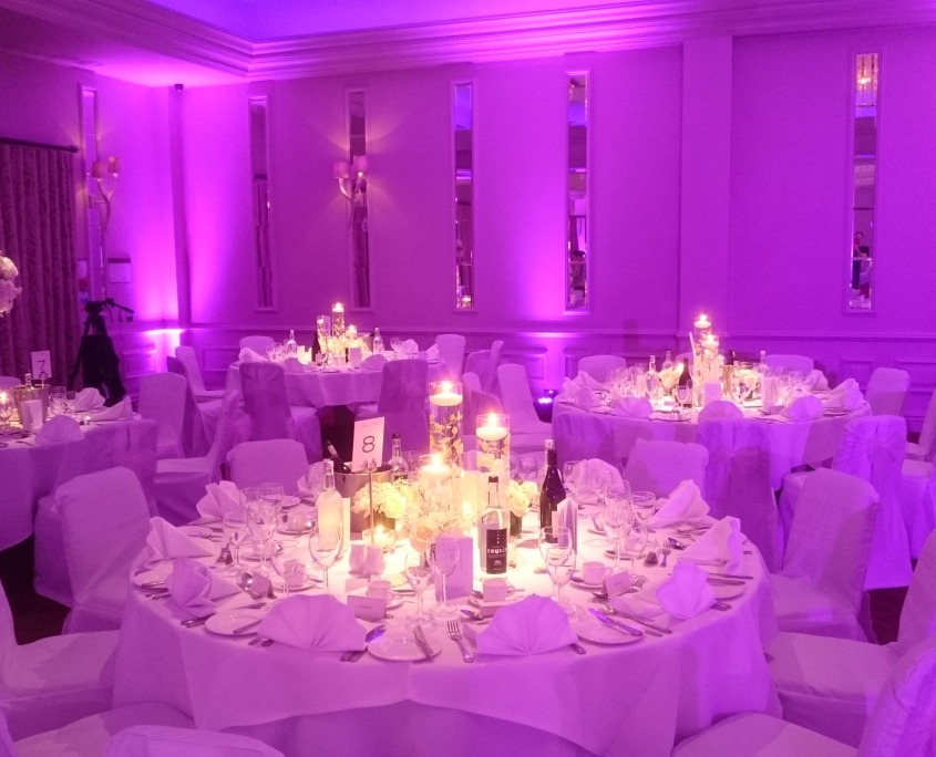 pink uplighters and table decorations