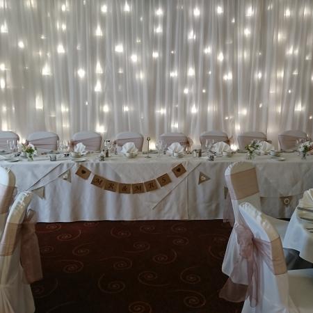 top table light up twinkle backdrop at hilton avisford ballroom 1