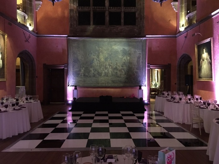 cowdray house black and white dancefloor and purple uplighters in bucks hall