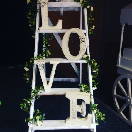 vintage love on tall ladder with climbing flowers